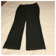 """Dockers Trouser Jeans Nice pair of dark wash, trouser jeans with the 'hello smooth' waistband. Has a tab and button closure and button flap back pockets. Only wore a couple of times and they are in great condition. Waist measures 16"""", inseam 31"""", leg opening 8"""", and rise 9"""" Dockers Jeans Boot Cut"""