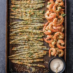 A hot oven is imperative when making this garlicky shrimp with asparagus recipe; it ensures that the asparagus fries emerge golden and crisp but the shrimp don't overcook in this easy sheet-pan dinner. Asparagus Fries, Shrimp And Asparagus, Asparagus Recipe, Recipes With Asparagus, Asparagus Soup, Zucchini Fries, Garlicky Shrimp, Sheet Pan Suppers, Gourmet