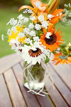 Nice blend of wildflowers for country wedding centerpiece | Outdoor Rustic Canadian Wedding: Smithers Driftwood Lodge