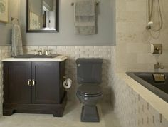 Colored sinks, toilets, and bathtubs are back in and look great with a textured tile!  Fixtures from Kohler.