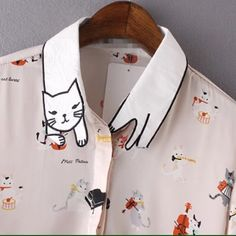 The cats meow blouse Meooooow this is adorable! This lovely little button up is coming soon. Price is $50. Comment size desired. Thanks ☺️ Tops Button Down Shirts