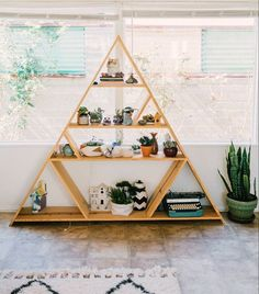 """#tbt to last week's gorgeous home tour and this handmade triangle bookcase! (Link in Profile, Home of @rcote_bandteesandlullabies, Photo by…"""