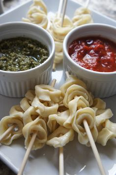 Tortellini skewers with pesto and marinara dipping sauces... such a cute and easy app!