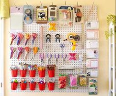 a large pegboard made out of $5 sections she purchased at the hardware store. Before hanging it on the wall, prime and paint the board white for a crisp look, then outfit it with different stage hooks, creating a tidy and tailored home for your tools