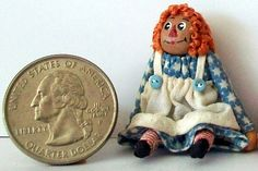 Miniature Raggedy Ann Doll (1 inch dollhouse scale).