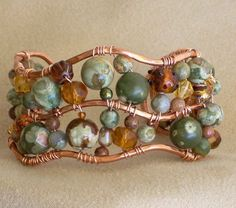 Copper and Rhyolite bracelet, very cool. Jewelry making tips, tricks & inspiration on this site.