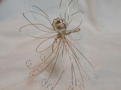 Silver Wire Angel decoration  ornament   wire sculpture. $13.50, via Etsy - kjs
