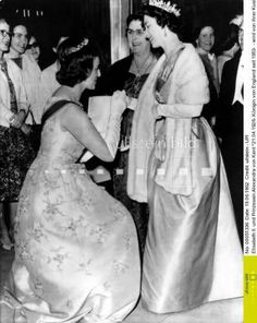 Days Of Majesty:  Princess Alexandra of Kent curtsies to her cousin Queen Elizabeth, 1963