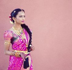South Indian bride. Gold Indian bridal jewelry.Temple jewelry. Jhumkis. Pink silk kanchipuram sari.Braid with fresh flowers. Tamil bride. Telugu bride. Kannada bride. Hindu bride. Malayalee bride.Kerala bride.South Indian wedding.