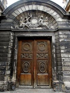 Marais ~ behind this stunning gate lies the magnificent Hôtel Amelot de Bisseuil.  Built in the late 1650s,