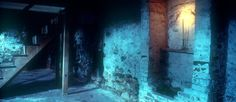 Color photo of the basement at the Poe House bathed in an eerie blue light, with a false chimney in the foreground and a flight of wooden steps in the background.