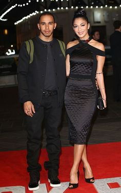 Nicole in a quilted gown with a high metal-detailed collar from Zeynep Tosun's Spring 2013 collection, and Lewis Hamilton wearing a Givenchy Pre-Spring 2013 Bomber