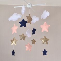 Clouds and stars baby crib mobile. An ideal gift for a new babys nursery or for room decor in an older childs bedroom.  This mobile consists of five