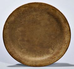 Skinner's - The Personal Collection of Lewis Scranton, Auction 2897M. May 21, 2016. Lot: 124.  Estimate: $200-250.  Realized: $425.   Description:  Small Treen Plate, America, dia. 6 1/2 in.   Provenance: Acquired from a 1698 home in North Branford, Connecticut, 1986.