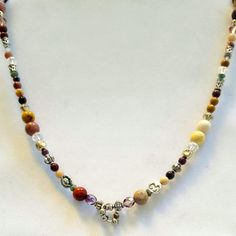 Benjamin Buttons  anti aging necklace, healing crystal and gemstone jewelry