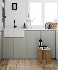 INSPIRATION: LAUNDRY: In our books, Saturday night is as good a time as any to plan a laundry overhaul. We're taking inspiration from the warm textures and fresh green hues of this laundry by @decusinteriors, featuring flooring by @cdkstone, tapware + basin by @cassbrothers, wall colour vivid white by @duluxaus, wall light by @_inlite_, benchtop by @smartstoneaustralia, joinery by @corelli_joinery in @porterspaints salt wattle and stool + accessories by @cultdesignau | Photography by…