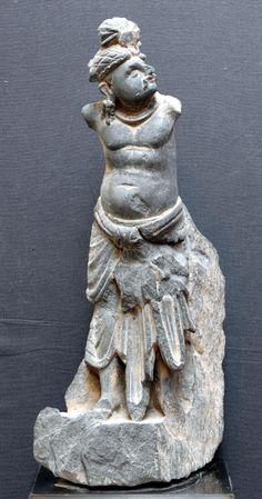 STANDING BODHISATTVA grey schist Gandhara-region, ca. 3rd. cent. high: 32,5 cm.
