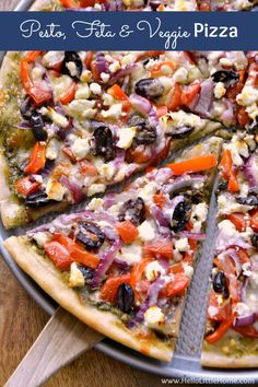 Pesto, Feta, and Veggie Pizza ... a delicious vegetarian pizza recipe that's impossible to resist! This easy, homemade veggie pizza recipe is packed with fresh vegetabless and flavorful, healthy ingredients. Make it tonight! | Hello Little Home