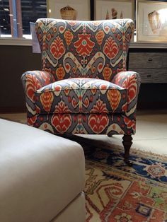Shades of vibrant oranges and blues make the pattern on this accent chair truly bold and beautiful! To give BIG personality to any space in your home, add this fun chair into the design scheme! Come see us at Gallery Furniture or click the pin to purchase it online & get this piece in your home, TODAY!   Houston TX   Gallery Furniture  