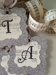music decor Vintage Looking Glitter Merry Christmas - initial / monogram gift tags - sheet music with hand lettering, cricut, stencil letters Christmas Gift Tags, Christmas Music, Winter Christmas, Vintage Christmas, Merry Christmas, Xmas, Sheet Music Crafts, Sheet Music Decor, Music Paper