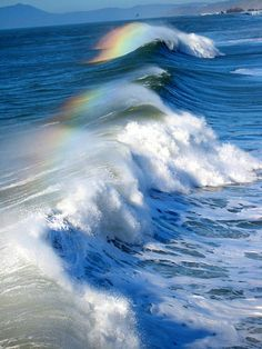 Waves and a beautiful rainbow.