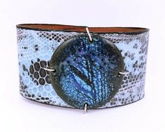 Glazed enamel snake skin bracelet.  Two snaps on back to attach.  The enamel is somewhat smaller than it appears.