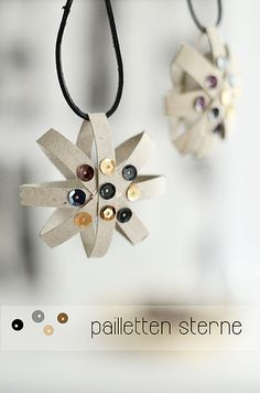 I had no idea these were cut from toilet paper rolls.  Crazy, simple & pretty :)  Necklace or Christmas Ornament.