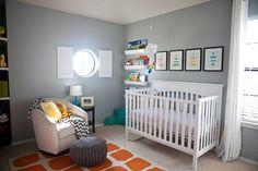 Gray Eclectic Nursery with Beautiful Pops of Color! #orangerug #nurserydecor