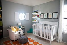 Gray Eclectic Nursery with Beautiful Pops of Color! #orangerug #nurserydecor