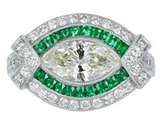 Art Deco Style Marquise Shaped Diamond and Emerald Ring