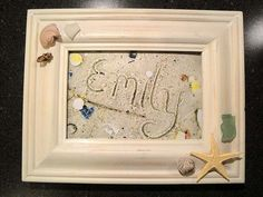 Take a pic of kids names in the sand and then let decorate the frames.