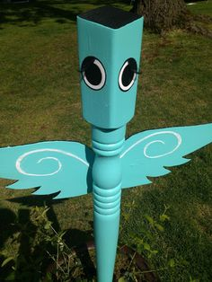 "Garden art angel made from a salvaged table leg.  Had real ""fake eyelashes""!  To cute! www.recycledsmiles.com"