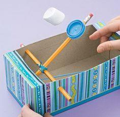 A Marshmallow Catapult for kids made from 2 pencils, a rubber band, a shoe box, and a milk cap. These would be fun and safe to create during force and motion lessons. http://hative.com/diy-ideas-with-recycled-shoe-box/