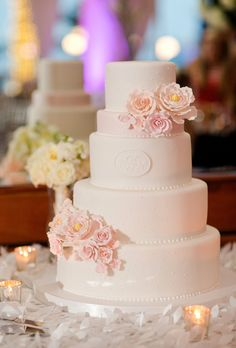 Brides.com: 32 of the Prettiest Floral Wedding Cakes. Classic white and pink monogrammed wedding cake with pink sugar flowers, by Fluffy Thoughts. See more monogrammed wedding cakes.