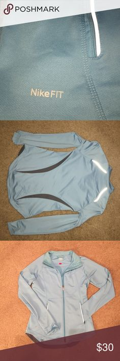 Nike dri fit full zip jacket Light blue Nike dri fit full zip jacket.  Zip pockets and hidden inside pockets to slide your iPhone in for a nice hands-free run. Nike Jackets & Coats