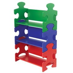 Primary Color Puzzle Piece Bookshelf by KidKraft    A unique place to display favorite books and toys. Decorative and functional furniture for a child's bedroom or playroom. Adds a playful touch to a classroom or daycare.    Three shelves included in colors of blue, red, and green.  25 in L x 11.75 in W x 37.5 in H