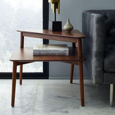 With its warm walnut finish and streamlined silhouette, our Mid-Century Stepped Side Table's design adds more space to display your favourite photos and latest reads.