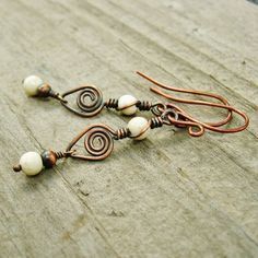Cream color riverstone beads are wire wrapped in antiqued copper wire, including swirls and bead dangles. Very earthy and rustic - perfect with
