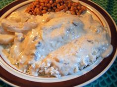 Hidden Valley Crockpot Chicken  8 chicken breasts  2 pkg of Hidden Valley Ranch dressing mix  16 oz sour cream  1 large can of cream of mushroom soup  Put into crockpot on low for about 5 hours (or until done depends on if your chicken is frozen or thaw), stirring occasionally.