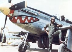 "U.S. Air Force Lt. Daniel ""Chappie"" James Jr. stands next to a P-51 in Korea. James first saw combat during the Korean War after arriving in Korea in August 1950. Serving with the 18th Fighter Wing and flying the P-51 Mustang and later the F-80 Shooting Star, James flew a total of 101 combat missions over Korea. (U.S. Air Force photo)"