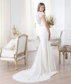 The Pronovias Laila has the soft sleek look of being a bride but also gives you the chance to do whatever you want to accessorize for your theme.