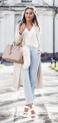 Just The Design: Kenza Zouiten is wearing a creme Ginatricot coat and blouse with baby blue high waisted trousers and white NYL heels. Idea for pantone 2016 color serenity and good outift for type 2 dyt