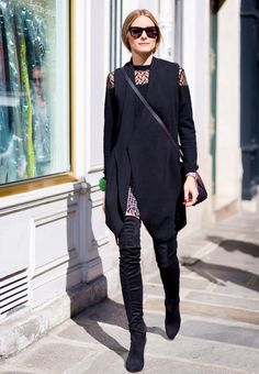 Try an eye-catching bare shoulder blouse and thigh-hight boots like Olivia Palermo