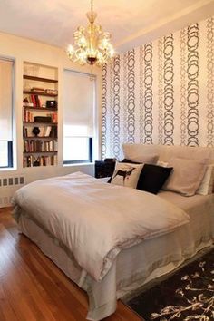 Small Bedroom Design Ideas, Pictures, Remodel, and Decor - page 4  This would be easy to accomplish in an apartment.  Removable wallpaper and hand a bookshelf on the wall.  I would paint the wall behind the bookshelf to bring in some added color along with a rug.