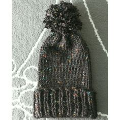 Handmade | Ribbed Knit Pom Beanie A slouchy, ribbed knit beanie in a black, speckled color with a fluffy pom in top! Super slouchy, but fits a bit tight at first. Will stretch over time. Hand made. Brand new. OSFM. (Circumference = about 18-inches, max) Accessories Hats