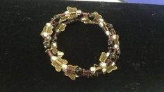 Purple and bronze butterfly beaded memory wire bracelet