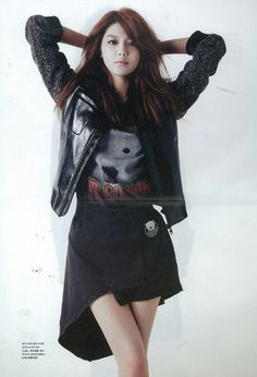Young grunge looking with leather jacket and tee + short skirt.