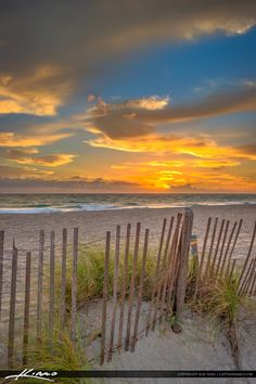 Sunrise at the beach in Jupiter, Florida along the fence at the inlet jetty. HDR image created in Photomatix Pro and TOpaz software.