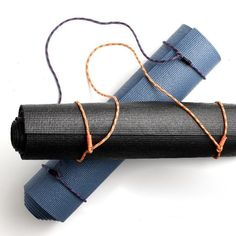Great idea-simple DIY yoga mat carrier made with accessory cord with a simple whipped loop on either end.