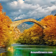 The colours of Autumn mixed with the Greek landscape create some truly stunning scenery such as the Konitsa Bridge in Epirus.  #Greece #Epirus #Autumn #travel #holidays #vacations #tourism #nature #bridges #aroundgreece #visitgreece